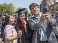 Man taking selfie with two women